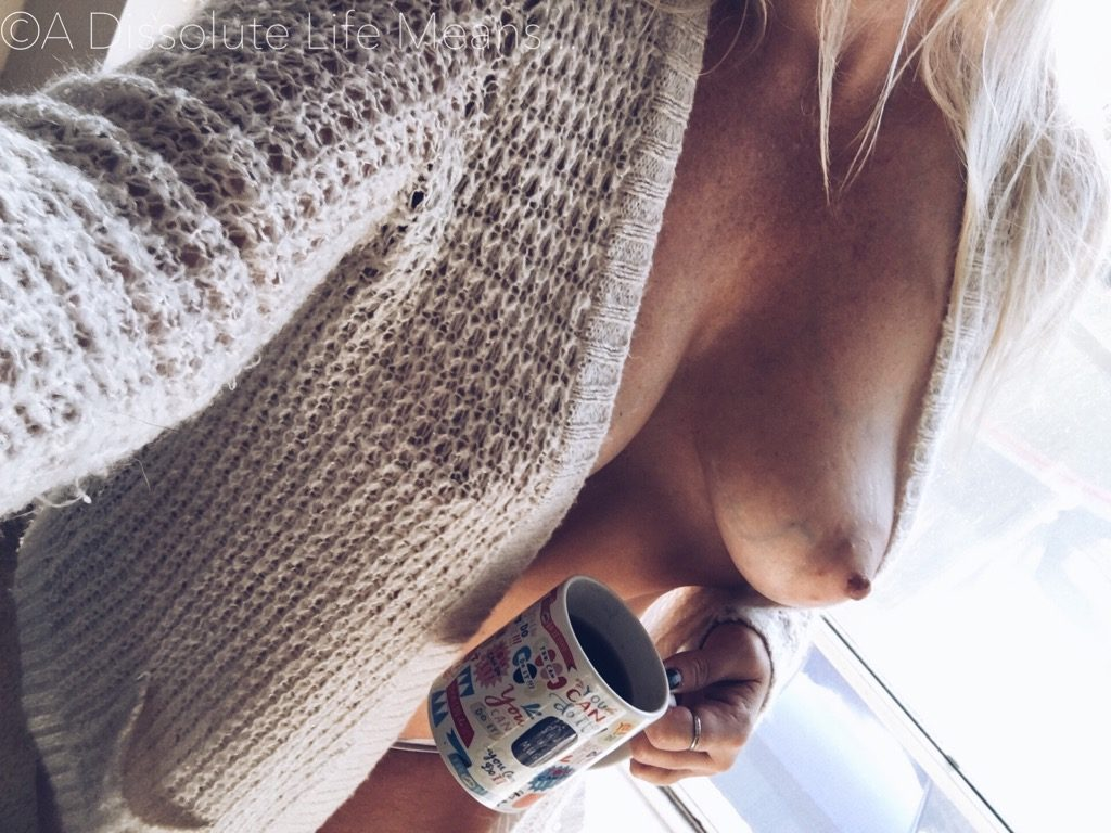 Hy in cardi with coffee